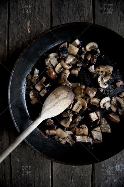 Sliced mushrooms in a pan