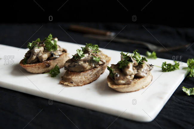 Toast topped with mushrooms and herbs