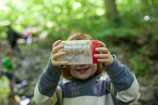 A girl shows off a salamander she caught
