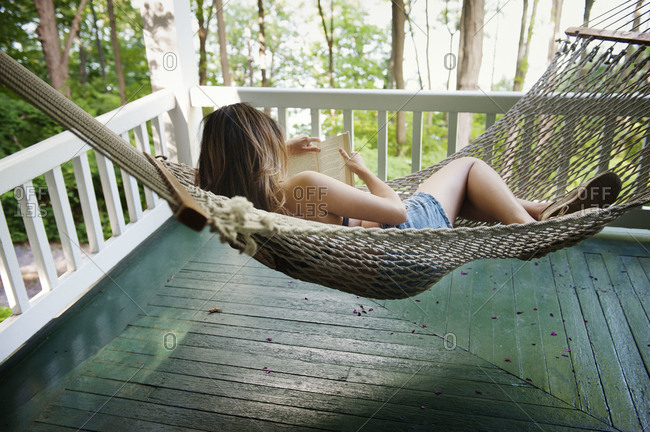 Woman reading book on hammock