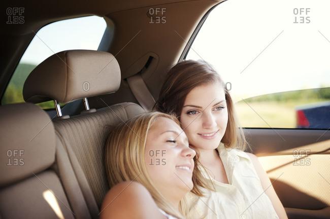 Female friends relaxing in car