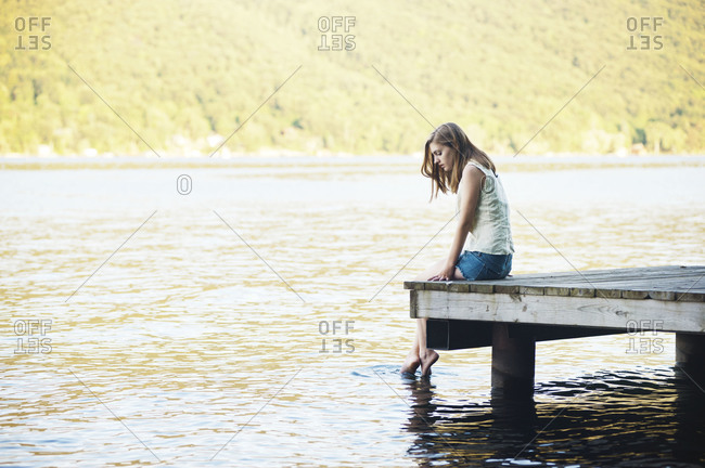 Young woman at end of dock