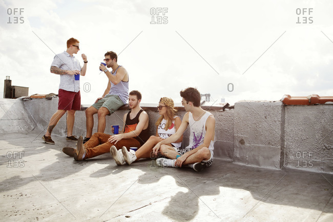 Hip friends hanging out on city roof
