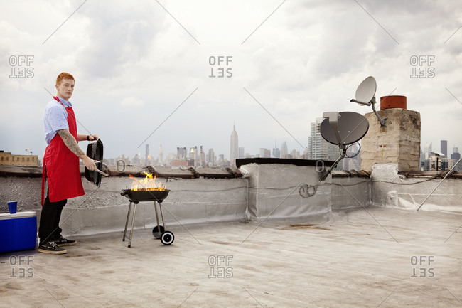 Young man working the grill