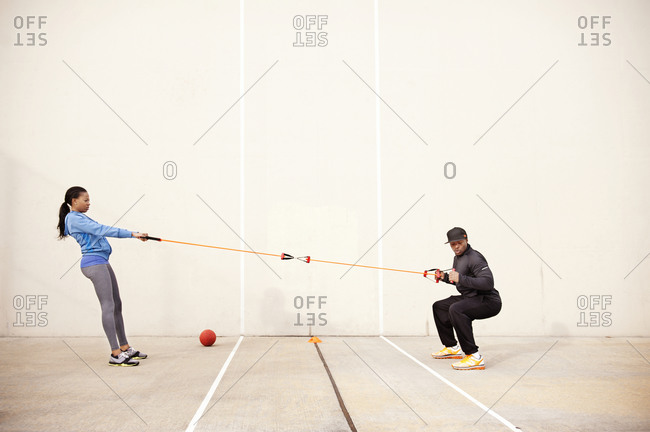Woman and her trainer doing resistance training