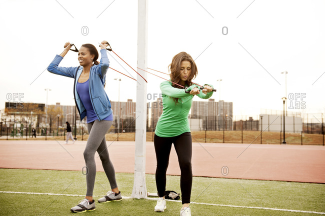 Two women doing resistance training