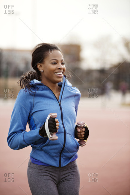 Woman jogging in city in cold