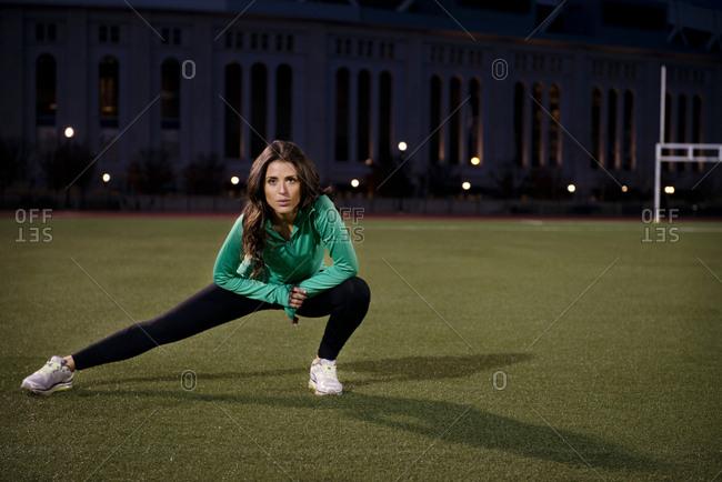 Woman stretching at night