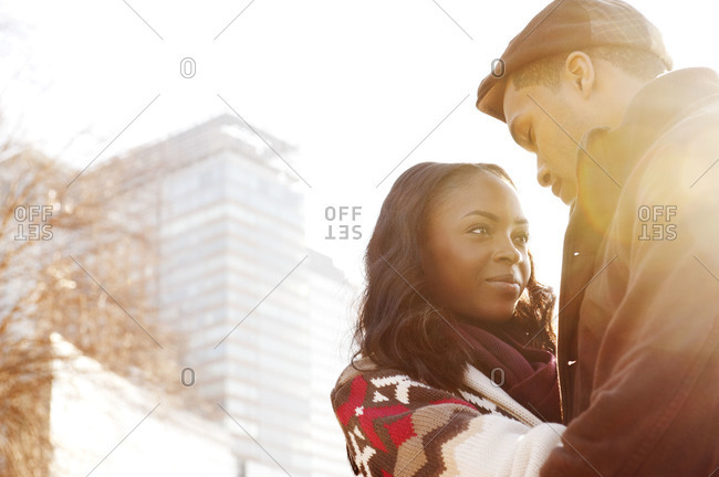 Young couple embracing in the early evening light