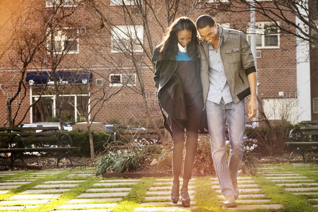 Young couple walking together in courtyard