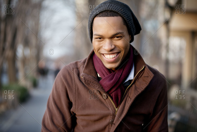 Portrait of a young man laughing in the park