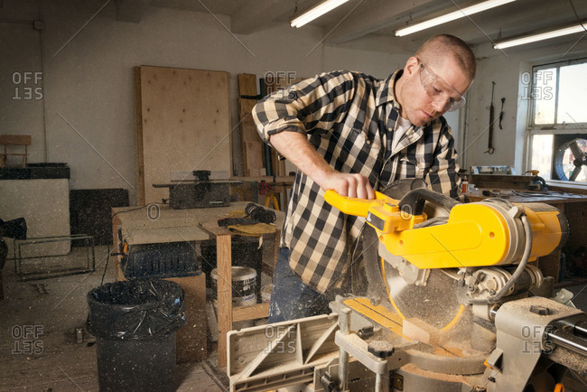 Carpenter using miter saw
