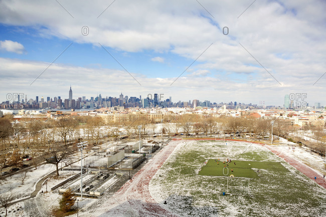 Aerial view of soccer field with Manhattan in background