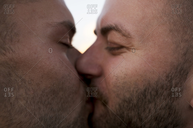 Close up of two men kissing