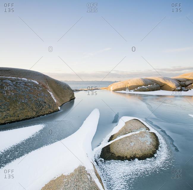 Sea with rocks in winter in Sweden