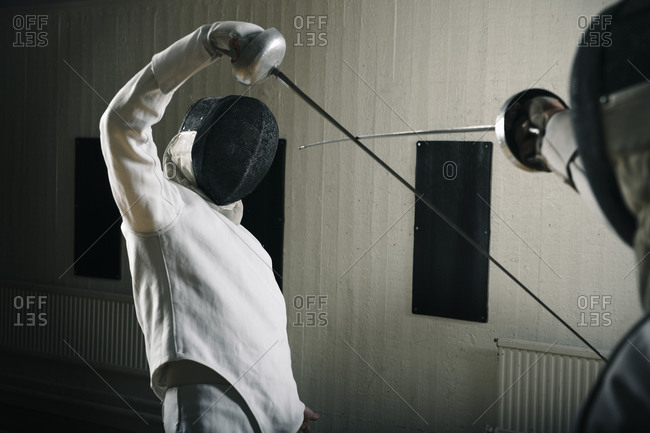Opponents fighting in a fencing match