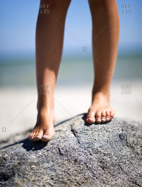 Close up of girl standing on a rock
