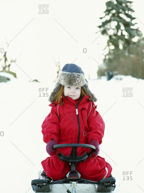 Girl sitting on a sledge