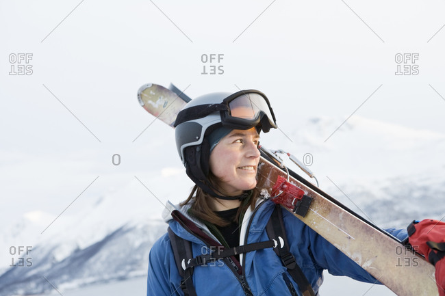 Portrait of woman holding skis