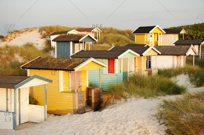 Colorful huts on the beach at sunset