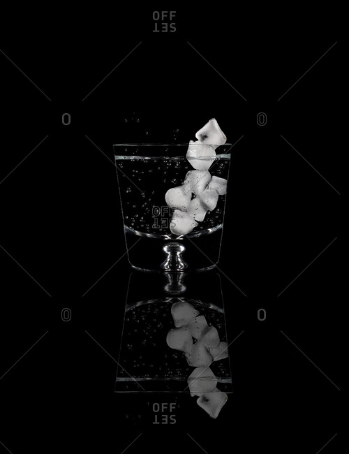 Studio shot of ice cubes in a glass of water