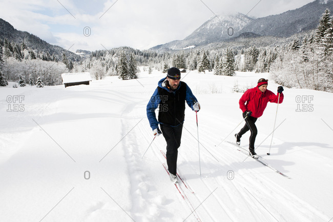 Two men cross country skiing in Germany