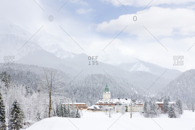 View of a snowy village surrounded by mountains
