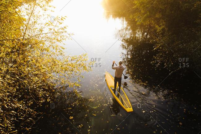 Man paddle boarding in Sweden