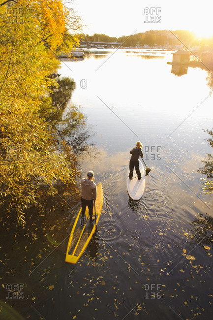 People paddle boarding in Sweden