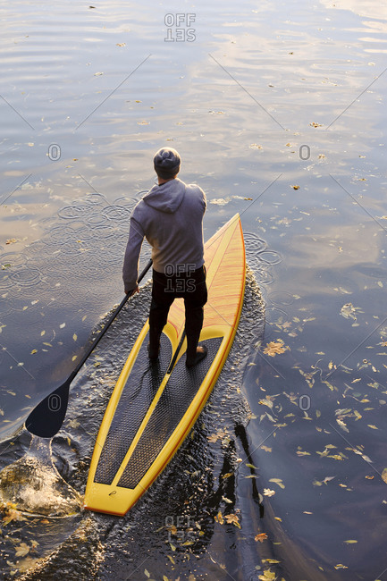 Man paddle boarding on a river
