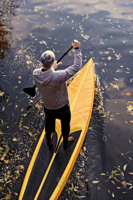 Man paddle boarding on a Swedish river