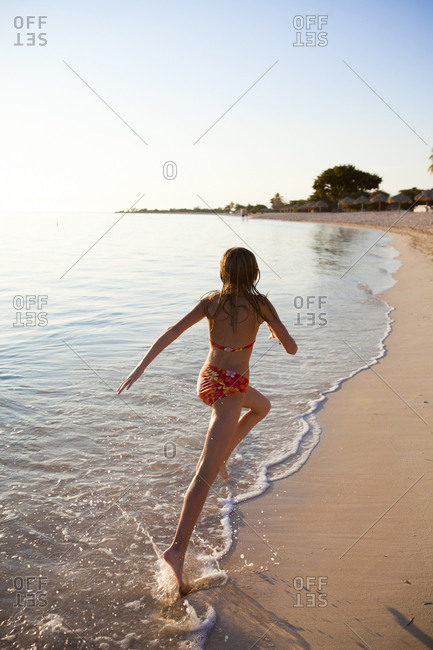 Young girl running on a beach