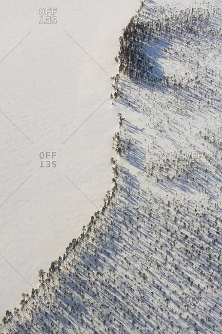 Aerial view of a Swedish lake at winter