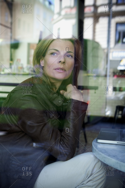 Businesswoman staring out of a window