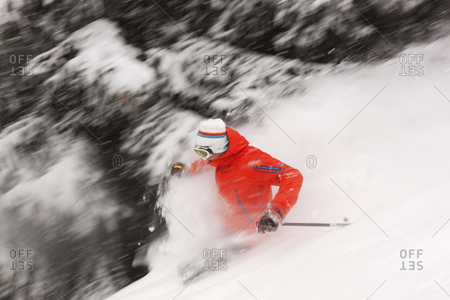 Man backcountry skiing on a snowy slope