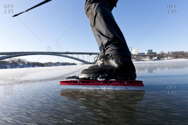 Man ice-skating in Stockholm, Sweden