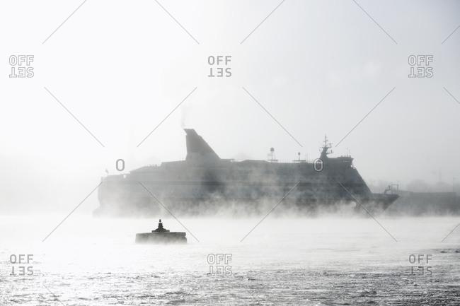 Ferry sailing in fog