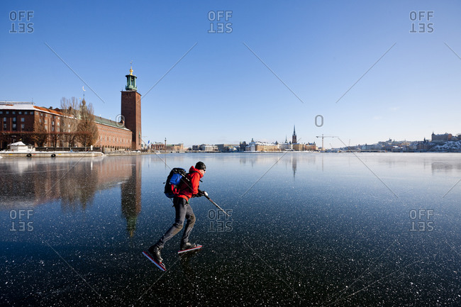 Man ice skating on lake Malaren