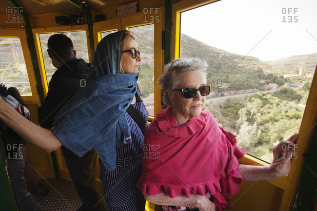 Women traveling by a cable car in Barcelona, Spain