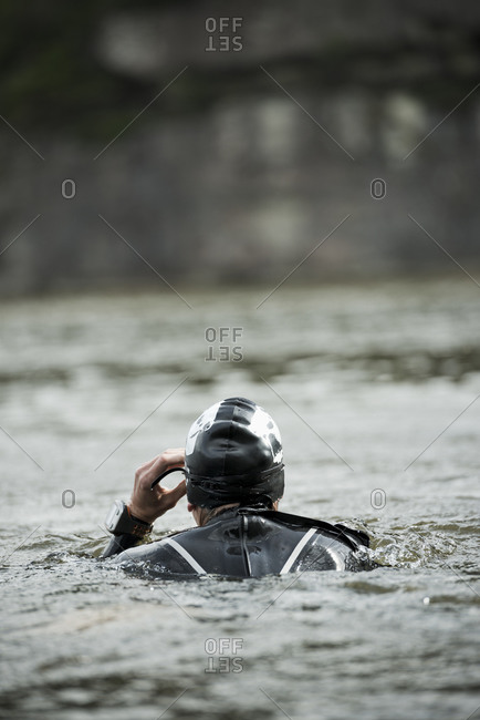 Woman in wetsuit swimming in a lake
