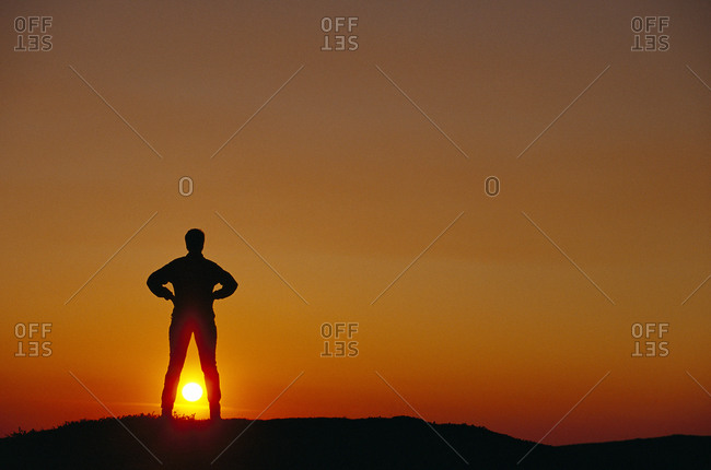 Silhouette of person in the sunset