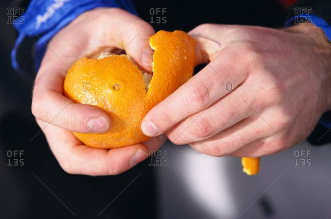 An orange being peeled