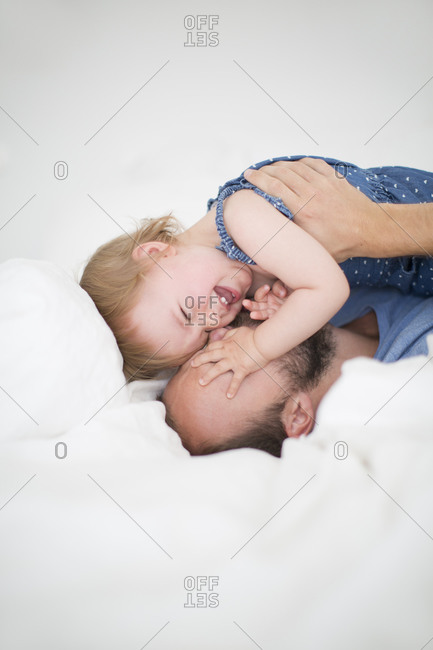 Father playing with her daughter