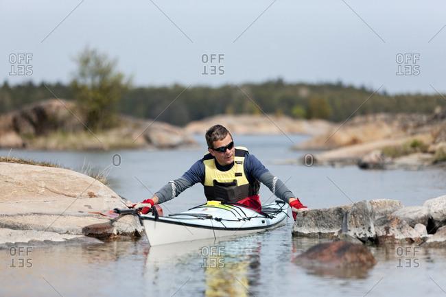 Man kayaking in Sweden