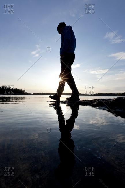 Silhouette of a walking man