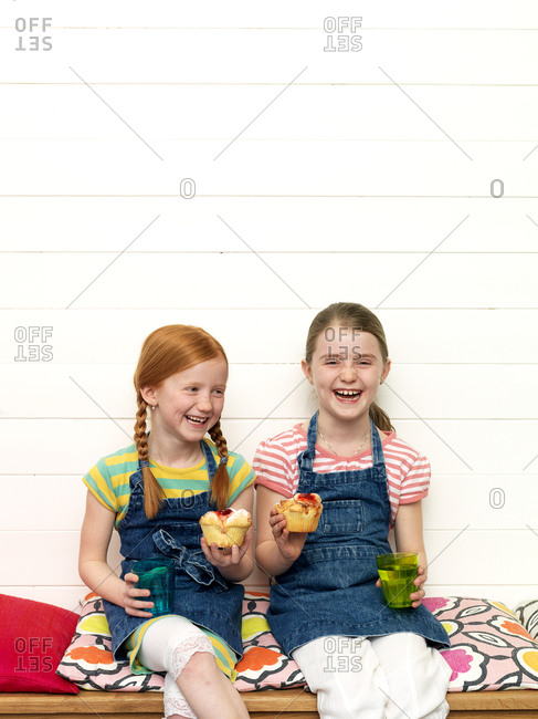 Two girls with cupcakes and lemonade
