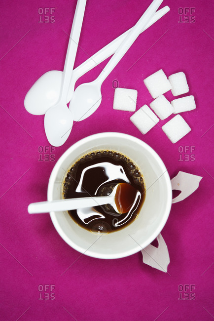 Studio shot of coffee with sugarcubes and spoons