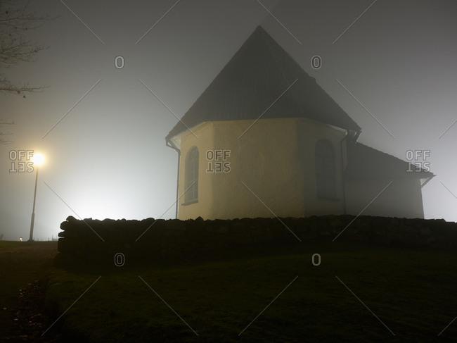 Church in fog at night