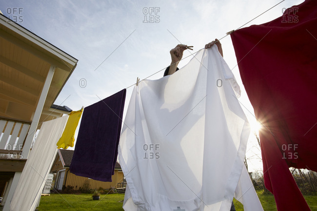 Person hanging laundry outdoors