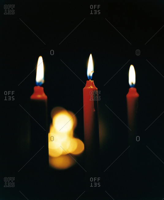 Red candles against a black background